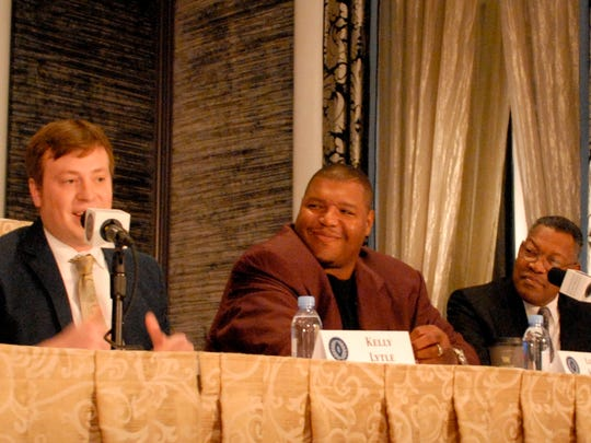 Kelly Lytle (left), on behalf of his late father Rob, speaks during a press conference prior to the induction of the 2015 class of the College Football Hall of Fame, of which Rob Lytle is a member. Fellow inductees Lincoln Kennedy, of the University of Washington (middle) and Clinton Jones (Michigan State), looks on.
