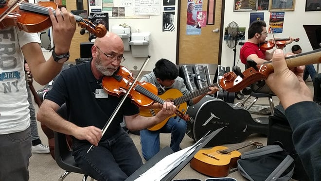 Mariachi teacher Darrell Downey practices with his class Wednesday at Bowie High School in South El Paso.