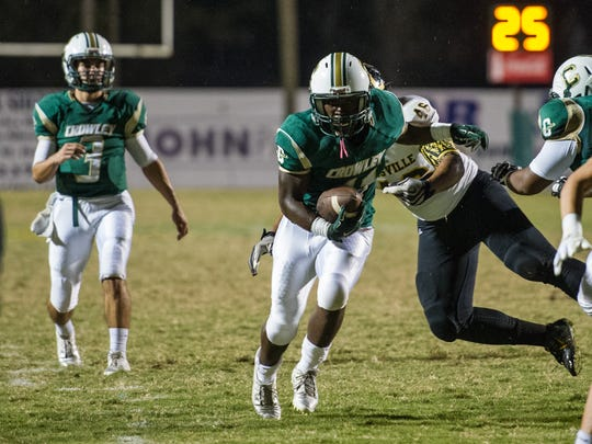 FILE -- Crowley running back Keith Wilson (11) breaks away from a tackle for a touchdown during 2015 game against Leesville.