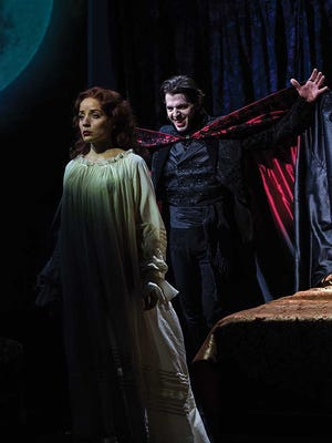 "Jamie Ann Romero plays Lucy and Tyler Pierce stars int the title role in the Utah Shakespeare Festival's 2015 production of ""Dracula."""