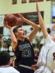 Hurricane's Jackson Last goes up for a contested shot