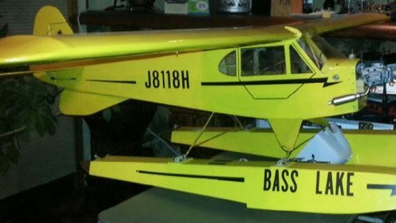 "Between Aug. 5 and 7, 2016, someone went into a garage in the town of Elderon and stole two model aircraft. As pictured here, one was a yellow 1/5th scale Cub replica pontoon plane, with ""Bass Lake"" lettered on the pontoons. Both of these aircraft were homemade by the victim of the theft. Also stolen was an oak wooden box, which had accessories for the Cub airplane."