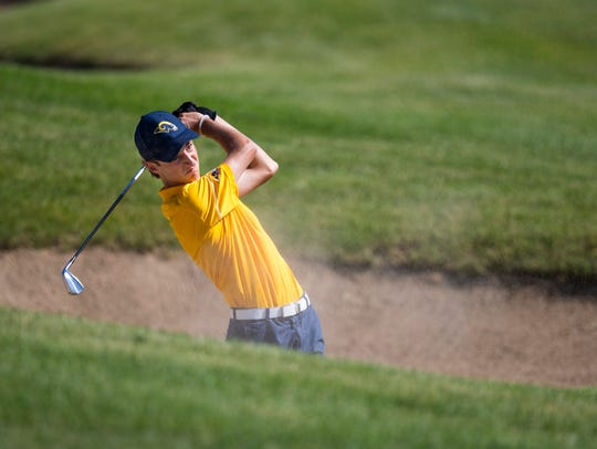 Marquette's Andrew Sagrillo chips his ball out of a