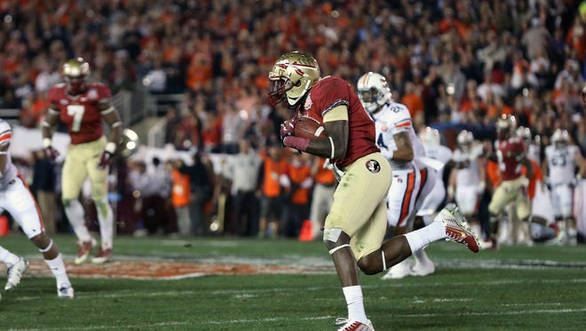 Florida State's Karlos Williams carries the ball on a fake punt in the second quarter of the BCS championship game.