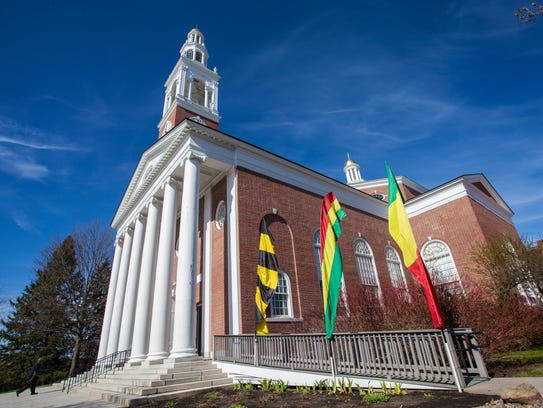 Flags outside UVM's Ira Allen Chapel during Friday's