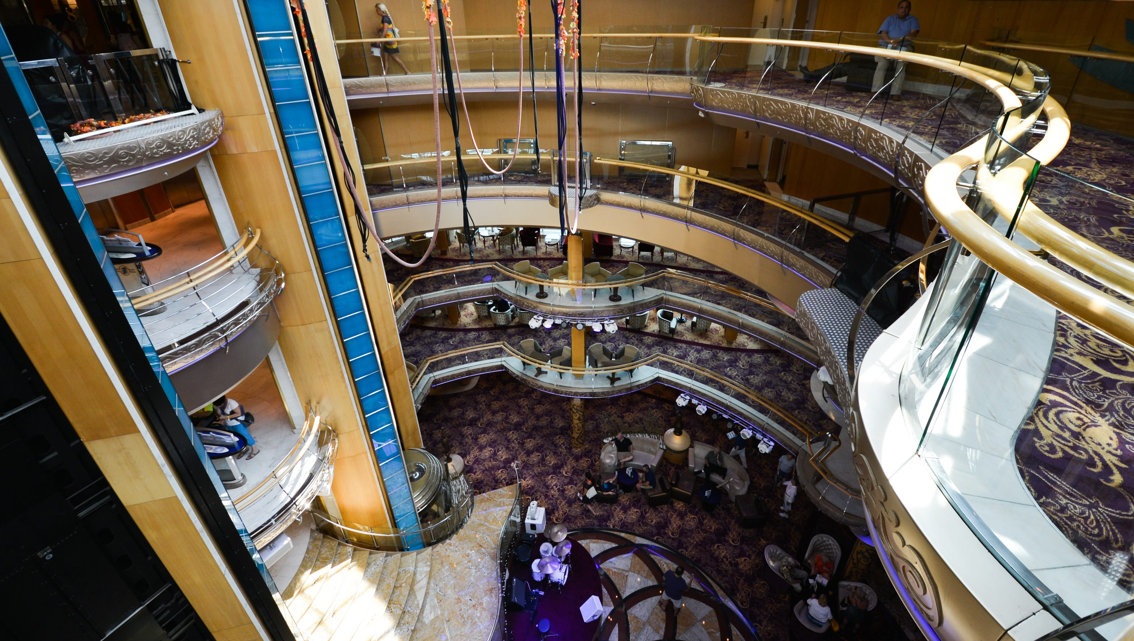 The Centrum was modified during Grandeur of the Seas' 2012 makeover to allow for three new aerialist shows in which performers dangle from lines attached to the ceiling.