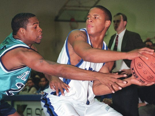 Long Branch's Raheem Carter, playing for Monmouth University in a game against St. Peter's in  LONG BRANCH., Monmouth University's #3 Raheem Carter in 2000.