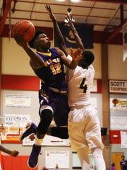 Wossman guard Jatarrius Turpin jumps to shoot a basket