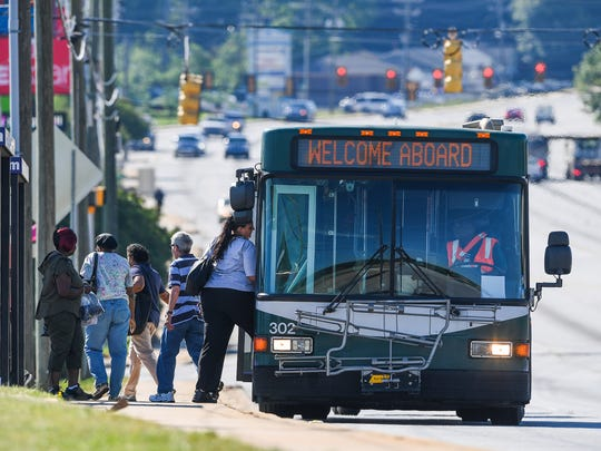 Passengers board a Greenville city bus on White Horse Rd. in Greenville on Tuesday, May 16, 2017.