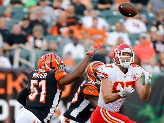 Kansas City Chiefs tight end Travis Kelce (87) makes a catch deep over the middle in the first quarter of the NFL Preseason Week 2 game between the Cincinnati Bengals and the Kansas City Chiefs at Paul Brown Stadium in downtown Cincinnati on Saturday, Aug. 19, 2017. At halftime the Bengals trailed 16-9.