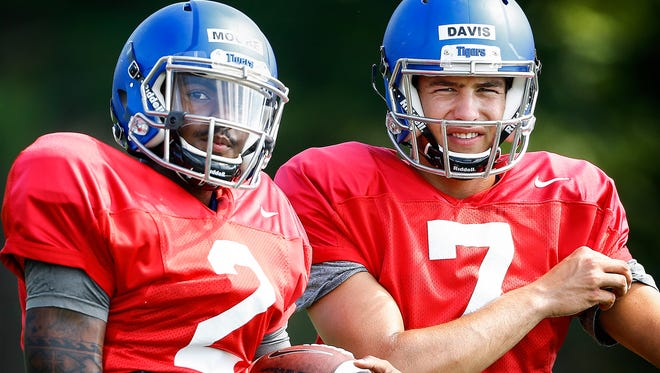 University of Memphis backup quarterbacks David Moore (left) and Brady Davis (right) during practice Thursday afternoon.