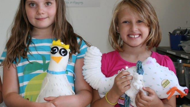 Alexa and Ava show the Soft Sculpture Creatures they created at Davis Studio in Burlington.