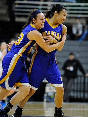 Marian's Brittany Gray, left, and Samantha Thomas celebrate Thomas' last-second shot to end the first quarter Saturday.