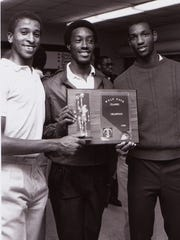 Dion Brown, center, shows off Wolfpack Classic championship
