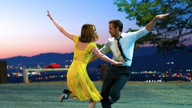 Mia (Emma Stone) and Seb (Ryan Gosling) fall in love against the backdrop of 'La La Land.'
