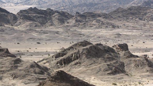 Craggy rocks and barren mountain outcrops form a lunar