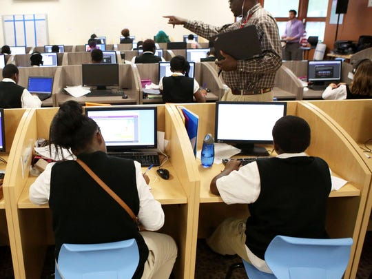 Carpe Diem-Aiken students start their school day in the learning center with independent computer learning in College Hill Thursday, October 1, 2015. 244 students in grades 7-12 attend the charter school.
