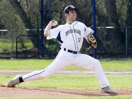 Elmira Notre Dame's Nate Snavely delivers a pitch against Tioga on April 21 in Southport.