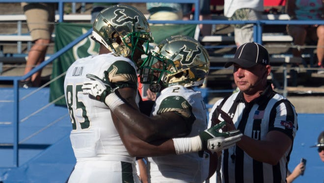 South Florida Bulls running back D'Ernest Johnson (2) is congratulated by tight end Elkanah Dillon (85) for scoring a touchdown against the San Jose State Spartans during the second quarter at CEFCU Stadium on Saturday.