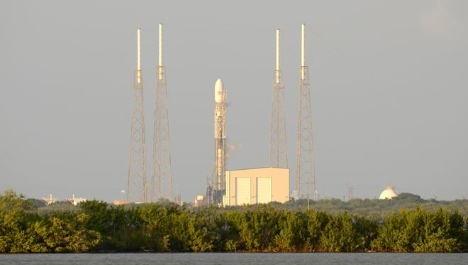 A SpaceX Falcon 9 rocket sits on the launch pad at Cape Canaveral Air Force Station, Fla., Thursday, Nov. 28, 2013.  The rocket, carrying the SES-8 telecommunications satellite failed to lift off due to technical issues.