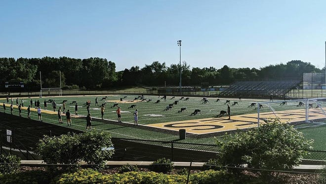 Athletes begin the first day of summer workouts at Hamilton High School.