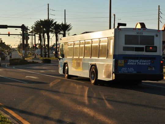 A Space Coast Area Transit bus travels near the Shepard