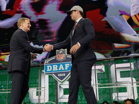 Commissioner Roger Goodell, left, greets USC's Sam Darnold after he was selected by the New York Jets during the first round of the NFL football draft, Thursday, April 26, 2018, in Arlington, Texas.