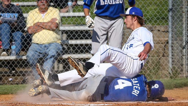 Highlands pitcher Drew Rom ends up sitting on Scott's Jake Pusateri as Pusateri scores on a first-inning wild pitch to give the Eagles a 4-0 lead during their game Thursday.