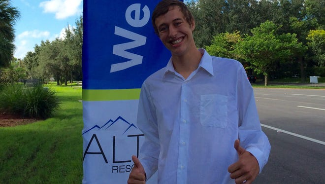 Matthew Hessert, 23, of Lehigh Acres, was all smiles after he accepted a job on the spot at Alta Resources.