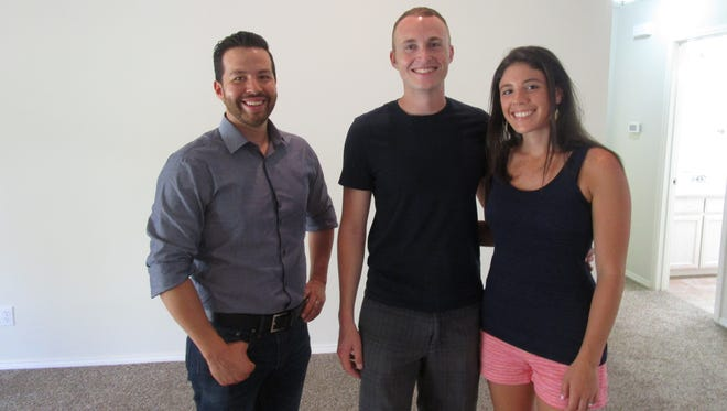 "Real estate agent Benjamin Beaver (from left) helps John and Mia, a military couple, find their perfect house in San Angelo on an episode of HGTV's ""House Hunters."""