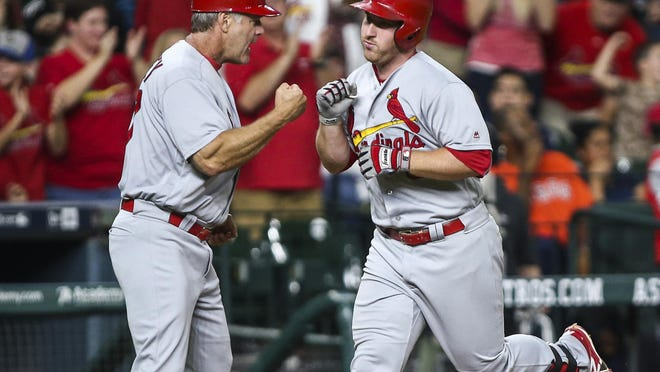 St. Louis Cardinals' Jedd Gyorko, right, celebrates with third base coach Chris Maloney after hitting a three-run home run during the sixth inning against the Houston Astros at Minute Maid Park.