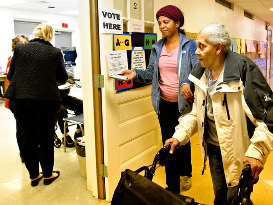 Helen Jackson, right, 91, is accompanied by her granddaughter Karla Coffman, both of Spring Garden Township, as she arrives at the Police Building in Ward 3 to vote on Election Day in Spring Garden Township, Tuesday, Nov. 8, 2016. Dawn J. Sagert photo