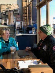 Jamie Watts, left, 36 of Washington, D.C. and Long Branch Mayor Adam Schneider share a few words at the  the Corner Cafe & Bistro in Pier Village. Watts has cerebral palsy and will be running the New Jersey Marathon in April, She was in Long Branch March 10 to train.