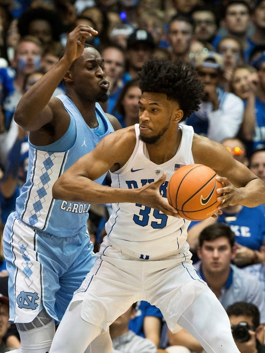 Duke's Marvin Bagley III (35) works against North Carolina's Theo Pinson during the second half of an NCAA college basketball game in Durham, N.C., Saturday, March 3, 2018. Duke defeated North Carolina 74-64. (AP Photo/Ben McKeown)