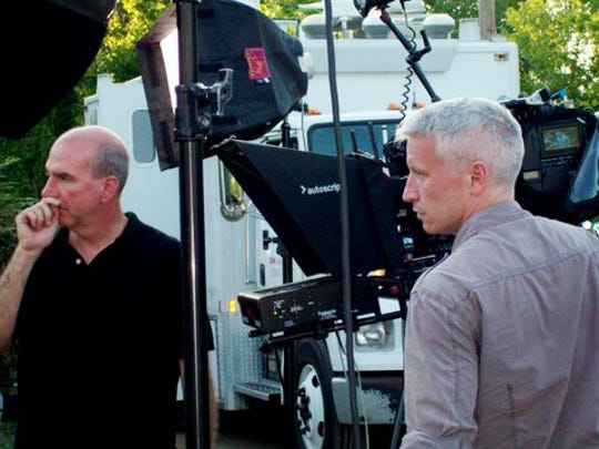 Anderson Cooper, right, and his CNN crew visit Nashville on May 6, 2010, to report on flood damage and the recovery effort.