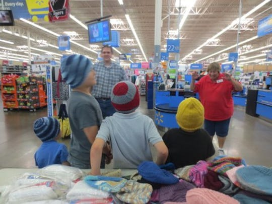 Volunteers with the Assistance League of Southern Utah take local children shopping for clothes.