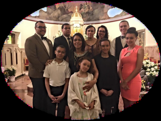 Pictured above is the late Tamara Wilson - Seidle, surrounded by her nine children.