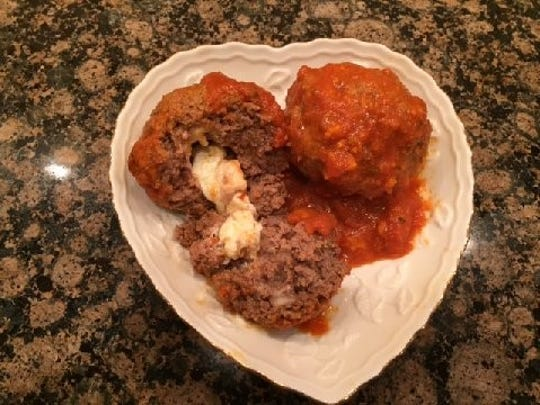 "Joanie Singer of Matawan has created her own ""Singer's Surprise Meatballs."""