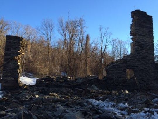 The stone wall of a 200-year-old barn at Camp Michaux fell earlier this week.