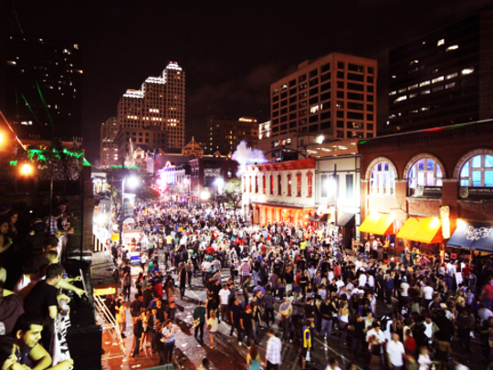 People flooding the streets of downtown Austin during SXSW, an annual music festival and conference.