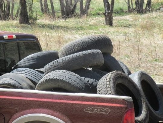 A pickup bed full of tires collected by Matthew Midgett