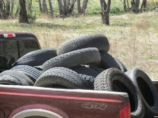 A pickup bed full of tires collected by Matthew Midgett on its way to a recycling event.