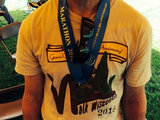 A medal for completing the 26-mile marathon walk hangs