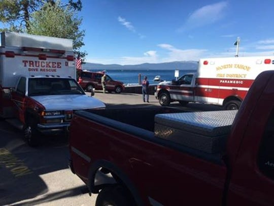Search and rescue crews look for a missing paddle boarder Friday at the Obexer's Marina on the west shore of Lake Tahoe.