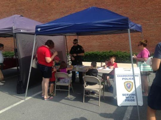 Chamersburg Police Department had a coloring station for kids at the North Square Farmers Market on Saturday, July 9. The department will set up a stand at the farmers market on five Saturdays this summer, as part of its effort to improve community policing.