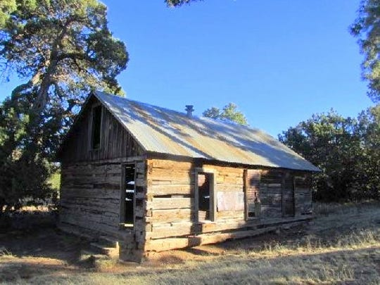 An old structure with a sturdy roof still stands and may have been used as a school house.