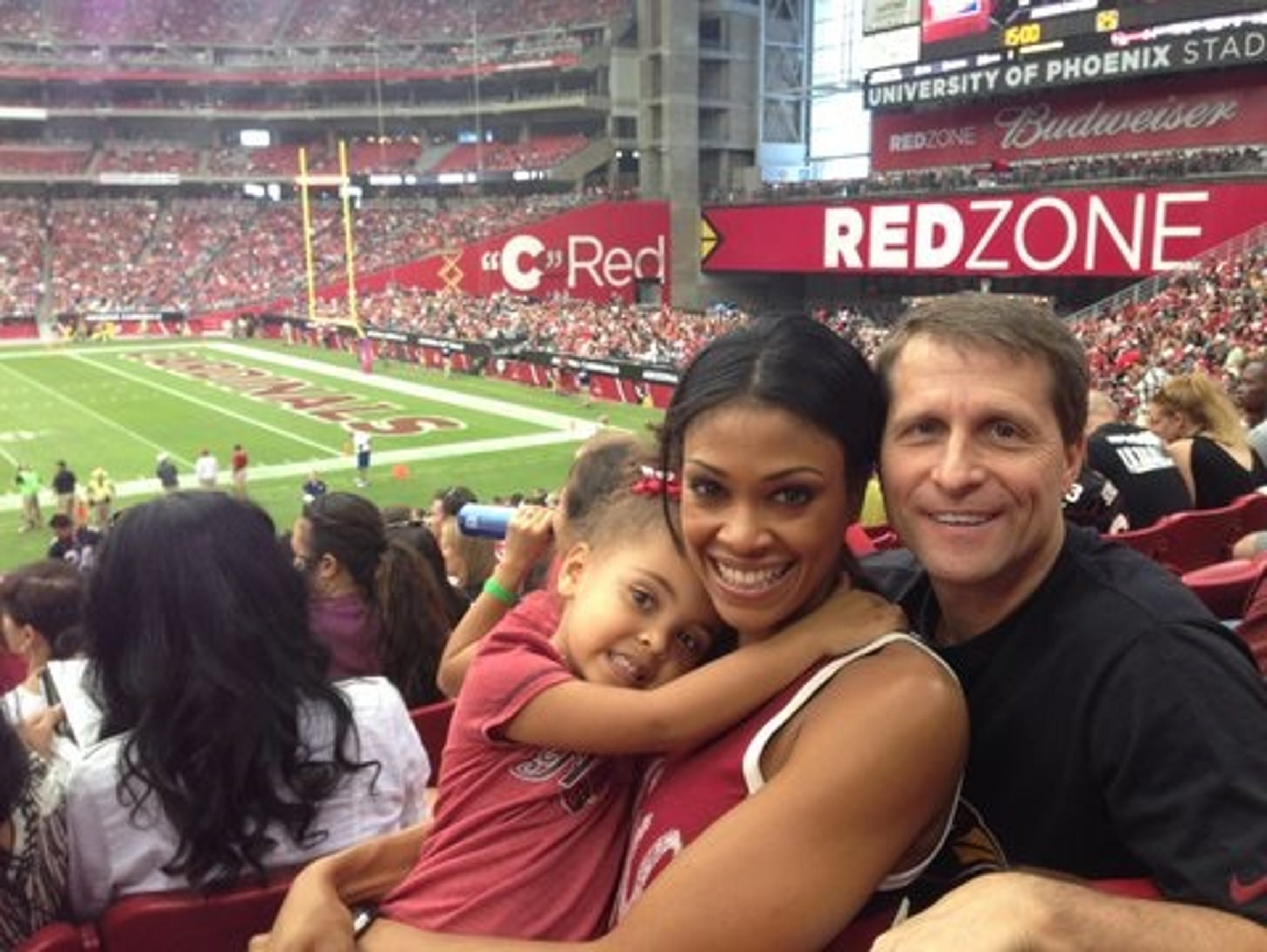 Danyelle and Eric Musselman with their daughter.
