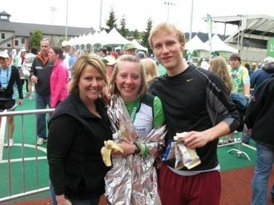 Thomas Chiapella, right, ran the last five miles in his sister, Nicole's, center, first marathon. Here they stand with their mother, Susan, left.