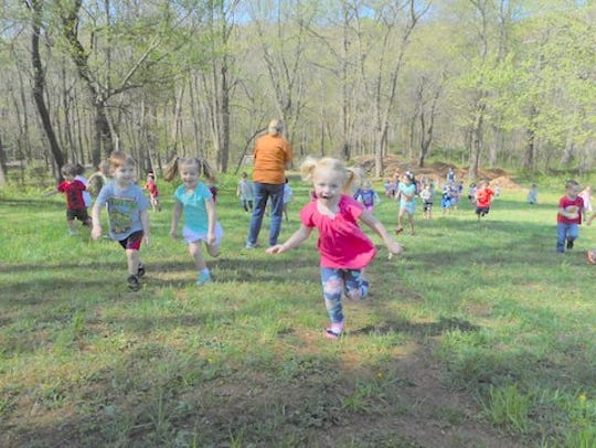 "Mountain Hill School students ""hike the hill"" to raise"
