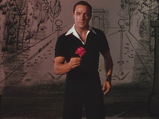 """Gene Kelly brought athletic grace to the 1951 movie """"An American in Paris."""""""